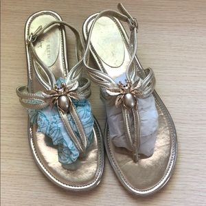 Gold sandals with bee detail